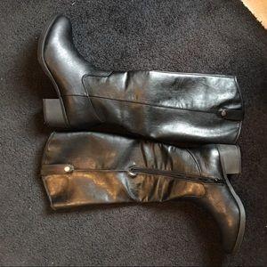 Tall black riding boot